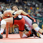 Elyria's Amando Torres tries works to control Hilliard Davidson's Aaron Assad during the Division I 113 pound championship match Saturday in Columbus.