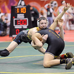 Black River's Mike Hozan battles with Carroll Bloom's Chandler Minnard during the Division III consolation match at the state tournament in Columbus on Saturday.