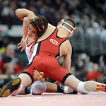 Elyria's Amando Torres tries for a take down on Hilliard Davidson's Aaron Assad during the Division I 113 pound championship match Saturday in Columbus.