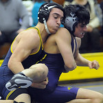 North Ridgeville's Will Keller, left, defeats Avon's Austin Matsko in the 126-weight class. STEVE MANHEIM/CHRONICLE