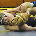 Avon's Max Bourque has North Ridgeville's Derrick Vilk trapped in a cradle during their 113-pound match Thursday night. STEVE MANHEIM/CHRONICLE