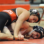 Elyria's Armando Torres, top, defeats Lorain's Brandon Bartlome in the 120 weight class. STEVE MANHEIM/CHRONICLE