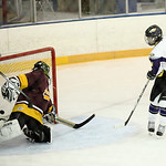 Avon&#039;s Eric Novakovic (#4) scores against Avon lake goalie Keegan Sullivan (#1). photo by Ray Riedel