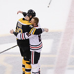 Boston Bruins defenseman Zdeno Chara (33), hugs Chicago Blackhawks right wing Marian Hossa (81), both of Slovakia, after the Blackhawks beat the Bruins 3-2 in Game 6 of the NHL hockey Stanle …