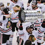 Chicago Blackhawks defenseman Michal Rozsival, of the Czech Republic, hoists the Stanley Cup after the Blackhawks beat the Boston Bruins 3-2 in Game 6 of the NHL hockey Stanley Cup Finals Mo …