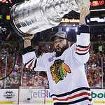 Chicago Blackhawks left wing Brandon Bollig hoists the Stanley Cup after the Blackhawks beat the Boston Bruins 3-2 in Game 6 of the NHL hockey Stanley Cup Finals Monday, June 24, 2013, in Bo …