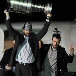 Chicago Blackhawks center Michal Handzus carries the Stanley Cup after arriving at O'Hare International Airport in Chicago, on Tuesday, June 25, 2013. (AP Photo/Paul Beaty)