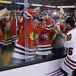 Chicago Blackhawks center Andrew Shaw celebrates with fans after the Blackhawks beat the Boston Bruins 3-2 in Game 6 of the NHL hockey Stanley Cup Finals Monday, June 24, 2013, in Boston. (A …