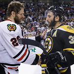 Chicago Blackhawks center Michal Handzus (26), of Slovakia, shakes hands with Boston Bruins center Patrice Bergeron (37) after the Blackhawks beat the Bruins 3-2 in Game 6 of the NHL hockey …