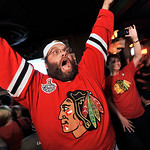 Chicago Blackhawks fans celebrate at The Crossroads bar in Chicago after the Chicago Blackhawks defeated the Boston Bruins 3-2 to win the Stanley Cup on Monday, June 24, 2013. (AP Photo/Paul …