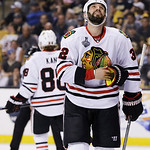 Chicago Blackhawks defenseman Michal Rozsival (32), of the Czech Republic, looks to the scoreboard during the second period in Game 6 of the NHL hockey Stanley Cup Finals against the Boston  …