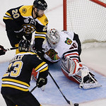 Boston Bruins left wing Daniel Paille (20) moves the puck in front of Chicago Blackhawks goalie Corey Crawford (50) during the third period in Game 6 of the NHL hockey Stanley Cup Finals, Mo …