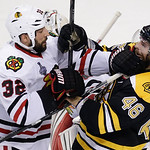 Chicago Blackhawks defenseman Michal Rozsival (32), of the Czech Republic, and Boston Bruins center David Krejci (46), of the Czech Republic, tangle during the third period in Game 6 of the  …