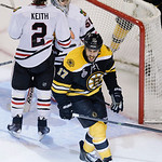 Boston Bruins left wing Milan Lucic, foreground, reacts after scoring past Chicago Blackhawks defenseman Duncan Keith (2) and goalie Corey Crawford, right, during the third period in Game 6  …