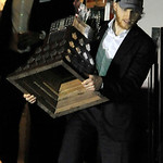 Chicago Blackhawks' Patrick Kane carries the Conn Smythe Trophy after arriving at O'Hare International Airport in Chicago, on Tuesday, June 25, 2013. The Chicago Blackhawks landed home with …