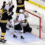 Boston Bruins left wing Milan Lucic, left, reacts after scoring past Chicago Blackhawks defenseman Duncan Keith (2) and goalie Corey Crawford, hidden during the third period in Game 6 of the …