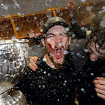 Chicago Blackhawks center Andrew Shaw celebrates with the Stanley Cup in the locker room after his team beat the Boston Bruins 3-2 in Game 6 of the Stanley Cup Finals, June 24, 2013 in Bosto …