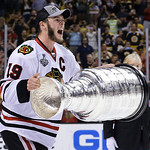 Chicago Blackhawks center Jonathan Toews hoists the Stanley Cup after the Blackhawks beat the Boston Bruins 3-2 in Game 6 of the NHL hockey Stanley Cup Finals Monday, June 24, 2013, in Bosto …