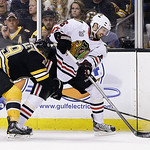 Boston Bruins center Rich Peverley (49) checks Chicago Blackhawks center Marcus Kruger (16) during the second period in Game 6 of the NHL hockey Stanley Cup Finals Monday, June 24, 2013 in B …