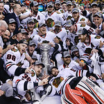 The Chicago Blackhawks pose with the Stanley Cup after the Blackhawks beat the Boston Bruins 3-2 in Game 6 of the NHL hockey Stanley Cup Finals Monday, June 24, 2013, in Boston. (AP Photo/El …