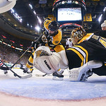 Boston Bruins defenseman Zdeno Chara (33), of Slovakia, turns the puck from the net in front of Boston Bruins goalie Tuukka Rask, right, of Finland, as Chicago Blackhawks right wing Patrick  …