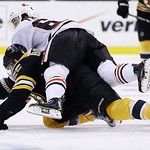 Chicago Blackhawks center Michael Frolik, top, of the Czech Republic, rides down Boston Bruins defenseman Johnny Boychuk (55) during the third period in Game 6 of the NHL hockey Stanley Cup …