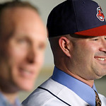 Cleveland Indians manager Manny Acta, right, smiles as he listens to vice-president and general manager Mark Shapiro speak to the media at a news-conference Monday, Oct. 26, 2009, in Clevel …