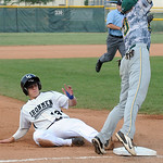 Ironmen's Cody Semler steals third base as the Miners Mike Brousseau jumps for the ball. STEVE MANHEIM/CHRONICLE
