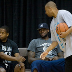 Cleveland Cavaliers assistant coach Melvin Hunt, right, talks with LeBron James, center,  and Cavs player Damon Jones at the LeBron James Skills Academy for high school and college basketbal …