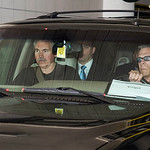 New York Knicks head coach Mike D'Antoni, left, is driven out of the IMG building in downtown Cleveland, after meeting with free agent basketball player LeBron James on Thursday, July 1, 201 …