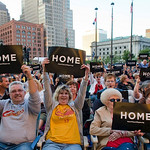 Doug, left, and Sharon, right, Mullins held up two of the approximately 20,000 signs that where handed out to the crowd at Cleveland's Independence Day celebration on Thursday, July 1, 2010  …