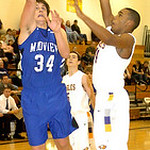 2-16-10 linda murphy</p> <p>Midview&#039;s #34 Riley Moore shoots past Avon&#039;s #44 Claude Gray.