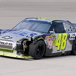 Jimmie Johnson drives his damaged car to the garage after wrecking on lap three of the NASCAR Sprint Cup Series auto race at Texas Motor Speedway on Sunday, Nov. 8, 2009, in Fort Worth, Texa …