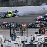 Driver Jimmie Johnson (48) spins out on lap three of the NASCAR Sprint Cup Series auto race after he was hit by Sam Hornish Jr. (77) at Texas Motor Speedway on Sunday, Nov. 8, 2009, in Fort  …