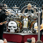 ZZ Top members Dusty Hill, left, Frank Beard (on drums) and Billy Gibbon, right, perform before the start of the NASCAR Sprint Cup Series auto race at Texas Motor Speedway, on Sunday, Nov. 8 …