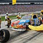 Crew members change tires on Kyle Busch's car during the NASCAR Sprint Cup Series auto race at Texas Motor Speedway, on Sunday, Nov. 8, 2009, in Fort Worth, Texas. (AP Photo/Ralph Lauer)