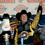 Kurt Busch poses with the Dickies 500 trophy after winning the NASCAR Sprint Cup Series auto race at Texas Motor Speedway on Sunday, Nov. 8, 2009, in Fort Worth, Texas. (AP Photo/Ralph Lauer …