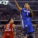 East All-Star Derrick Rose of the Chicago Bulls (1) scoops up a shot over West All-Star Deron Williams of the Utah Jazz (8) in the second quarter of the NBA All-Star basketball game Sunday,  …