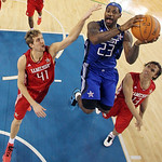 East All-Star LeBron James (23) of the Cleveland Cavaliers shoots between West All-Stars Dirk Nowitzki (41) of the Dallas Mavericks and Steve Nash of the Phoenix Suns in the second half of t …