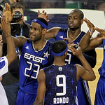 East All-Stars LeBron James (23) of the Cleveland Cavaliers, Dwyane Wade of the Miami Heat, and Dwight Howard (12) of the Orlando Magic high-five their teammates after the East beat the West …