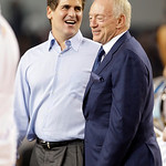Mark Cuban, left, owner of the Dallas Mavericks, and Jerry Jones, Dallas Cowboys owner, are seen together during a timeout in the fourth quarter of the NBA All-Star basketball game Sunday, F …