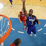 East All-Star Dwyane Wade (3) of the Miami Heat sails over West All-Star Amare Stoudemire of the Phoenix Suns (1) for a shot in the second half of the NBA All-Star basketball game Sunday, Fe …