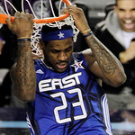 East All-Star LeBron James of the Cleveland Cavaliers hangs on to the rim after a dunk in the second half of the NBA All-Star basketball game Sunday, Feb. 14, 2010, at Cowboys Stadium in Arl …
