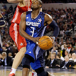 East All-Star Dwyane Wade (3) of the Miami Heat drives the ball against West All-Star Dirk Nowitzki of the Dallas Mavericks during the third quarter of the NBA All-Star basketball game Sunda …