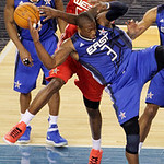 West All-Star Zach Randolph of the Memphis Grizzlies and East All-Star Dwyane Wade (3) of the Miami Heat battle for a rebound during the fourth quarter of the NBA All-Star basketball game Su …