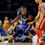 East All-Star Dwyane Wade of the Miami Heat drives the ball during the fourth quarter of the NBA All-Star basketball game Sunday, Feb. 14, 2010, at Cowboys Stadium in Arlington, Texas. (AP P …