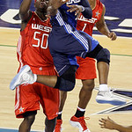 East All-Star Dwyane Wade of the Miami Heat looks at the basket as he goes up against West All-Stars Zach Randolph, left, of the Memphis Grizzlies and Amare Stoudemire, right, of the Phoenix …
