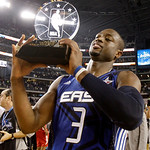 East All-Star Dwyane Wade of the Miami Heat holds the MVP trophy after the East beat the West 141-139 in the NBA All-Star basketball game Sunday, Feb. 14, 2010, at Cowboys Stadium in Arlingt …