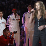 West All-Stars Steve Nash of the Phoenix Suns, Carmelo Anthony of the Denver Nuggets and Dirk Nowitzki of the Dallas Mavericks watch as Gretchen Wilson sings national anthem at the NBA All-S …