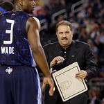 East coach Stan Van Gundy of the Orlando Magic talks with Dwyane Wade (3) of the Miami Heat in the fourth quarter of the NBA All-Star basketball game Sunday, Feb. 14, 2010, at Cowboys Stadiu …